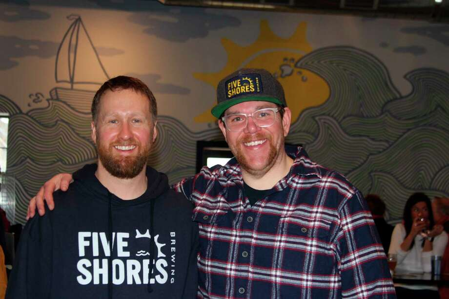 Co-founders Oliver Roberts (left) (brewmaster) and Matt Demorest at the grand opening of their brewery, Five Shores Brewing. (Photo/Colin Merry)