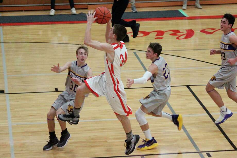 Benzie Central's Dray Hewitt flies toward the basket in transition. (Photo/Robert Myers)