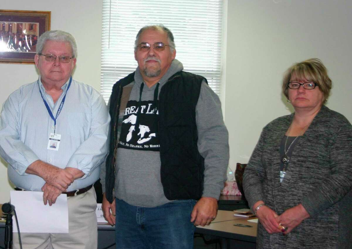 Rissell Wayne (center) was recognized for 30 years of service at the Osceola County Employee Recognition ceremony Jan. 22. Twenty-seven county employees were recognized for 5, 10, 15, 20, 25 and 30 years of service. (Herald Review photo/Cathie Crew)