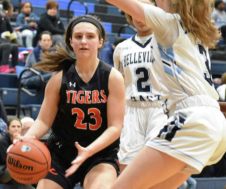 Edwardsville sophomore guard Macy Silvey drives to the basket during Tuesday's game against Belleville East in Belleville. Photo: Matt Kamp|The Intelligencer