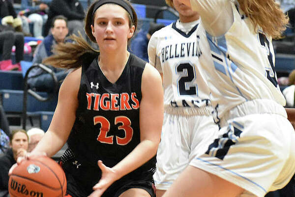 Edwardsville sophomore guard Macy Silvey drives to the basket during Tuesday's game against Belleville East in Belleville.