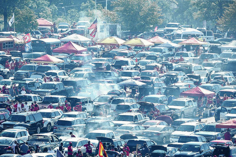 Smoke from tailgaters' barbecuing rises in the air prior to the Sept. 23, 2018, game between the Kansas City Chiefs and the San Francisco 49ers at Arrowhead Stadium in Kansas City, Missouri. For football fans, tailgating food is serious business. Super Bowl party food is close behind. Photo: David Eulitt | Getty Images