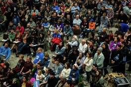 Attendees listen as Sen. Bernie Sanders speaks during a rally in Sioux City, Iowa, on Jan. 26, 2020.