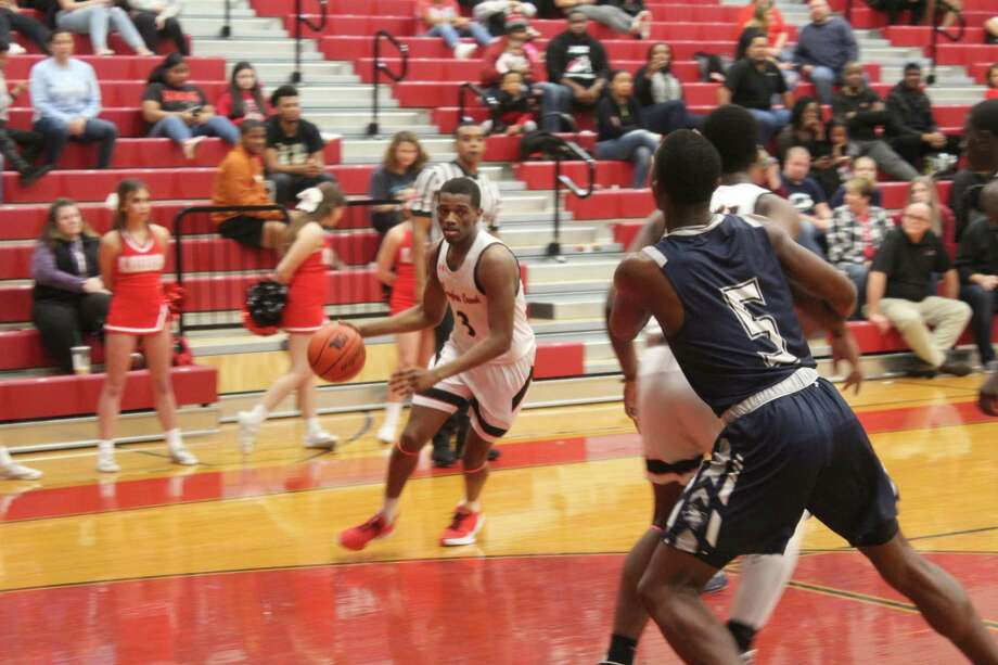 Langham Creek's Devion Jackson drives to the basket against Bryan in a District 14-6A matchup, Jan. 28, at Langham Creek High School. Photo: Staff Photo/Alvaro Montano