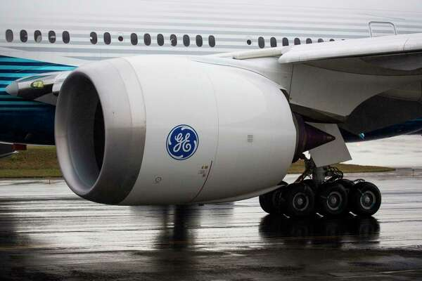 A General Electric GE9X engine is pictured on a Boeing 777X airplane as it taxis for the first flight, which had to be rescheduled due to weather, at Paine Field in Everett, Washington on January 24, 2020. (Photo by Jason Redmond / AFP) (Photo by JASON REDMOND/AFP via Getty Images)