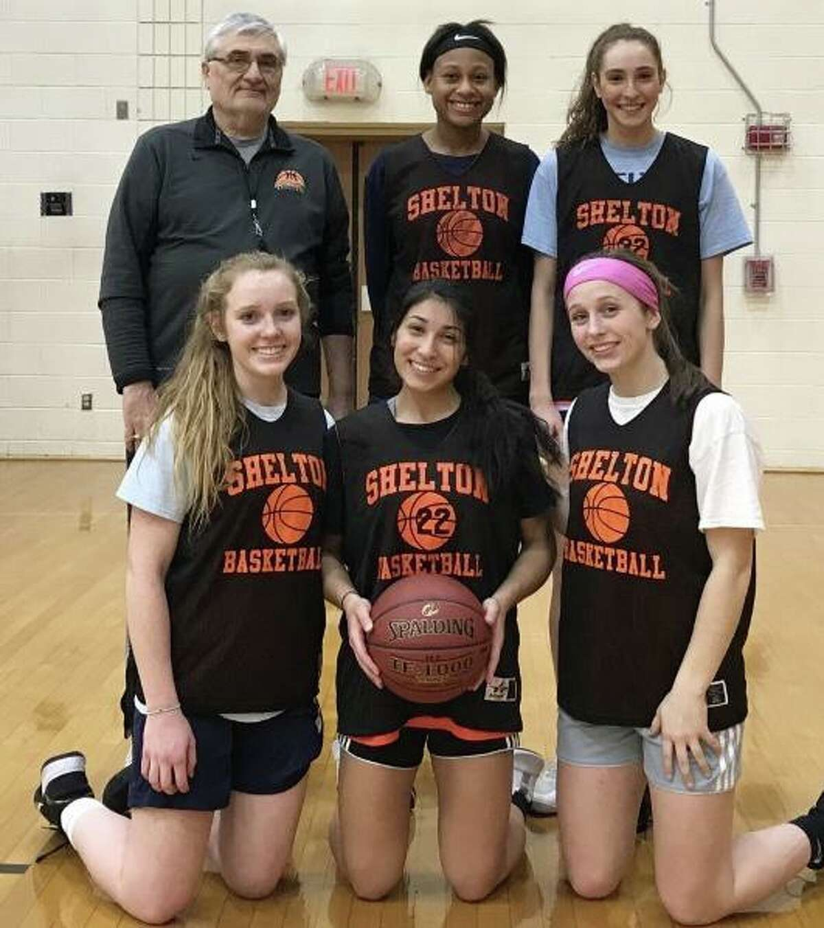 Shelton has opened its season with a 12-1 record. Pictured (front row) are Keira O'Connor, Leya Vohra and Devan Wildman; (second row) coach Joe Cavallaro, Clarissa Pierre and Reem Abdel-Hack.
