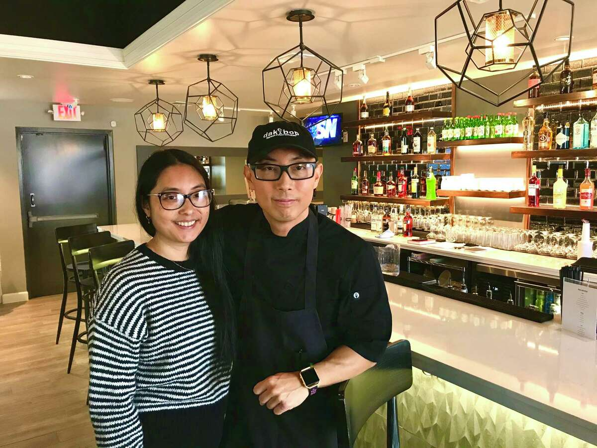 Dak & Bop owner Jason Cho with his wife Mary Cho in the new restaurant at1805 W. 18th.