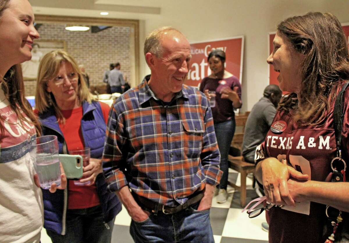 Gary Gates talks with supporters election night at his watch party in Richmond. Gates won the District 28 state representative seat. He received 17,457 votes to 12,617 for his Democratic opponent ElizMarkowitz.