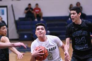Bobby Torres drives to the basket for the Alexander Bulldogs as Raul Pedraza defends for the Panthers Tuesday, January 28, 2020 at the Alexander Gym.