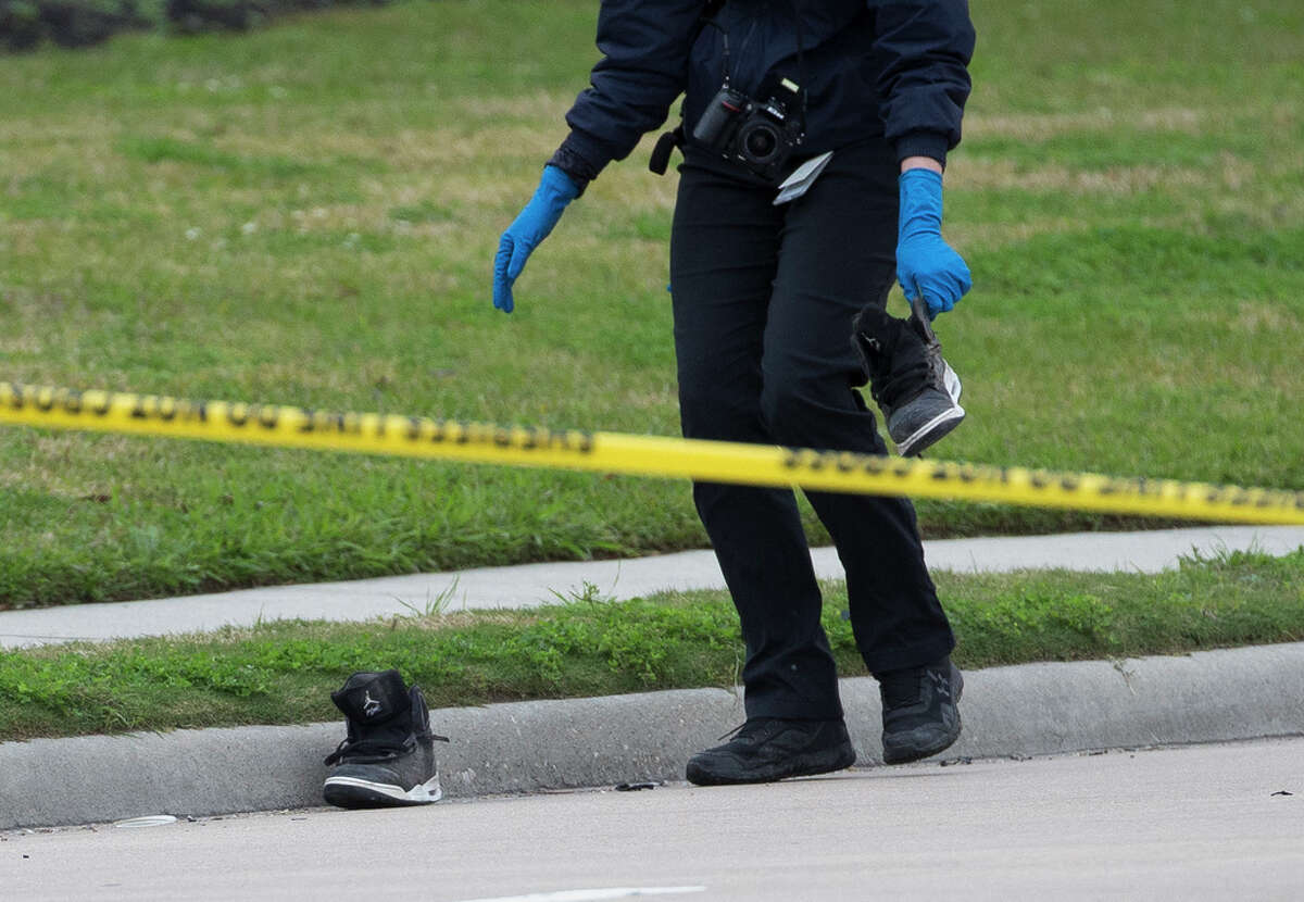 Harris County Institute of Forensic Sciences investigators investigate a fatal auto-pedestrian crash where an adult female pedestrian is deceased at the 5000 block of Aldine Bender Road Wednesday, Jan. 29, 2020, in Houston.