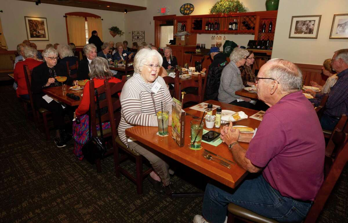 Sandy Lundy visits as members of the LIFT support group meet during a luncheon for the organization at Olive Garden, Monday, Jan. 27, 2020 in Conroe.