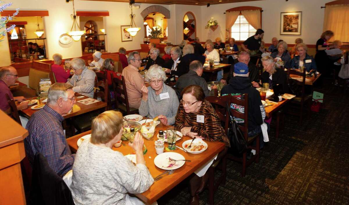 Members of the LIFT support group meet during a luncheon for the organization at Olive Garden, Monday, Jan. 27, 2020 in Conroe.