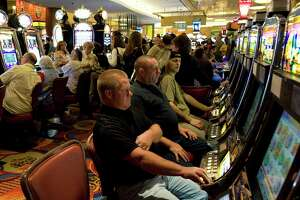 Under health protocols at Foxwoods Resort Casino in Mashantucket, gamblers will not be allowed to sit close to each other, as depicted in this file photo.