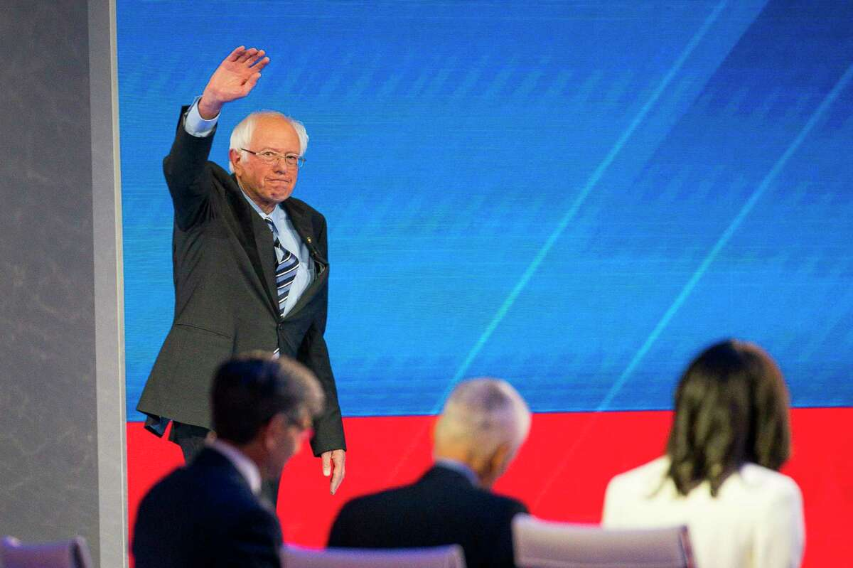 Democratic presidential candidate Sen. Bernie Sanders, I-VT, is welcomed to the stage during the Democratic presidential debate inside Texas Southern University's Health & PE Arena in Houston, Thursday, Sept. 12, 2019.