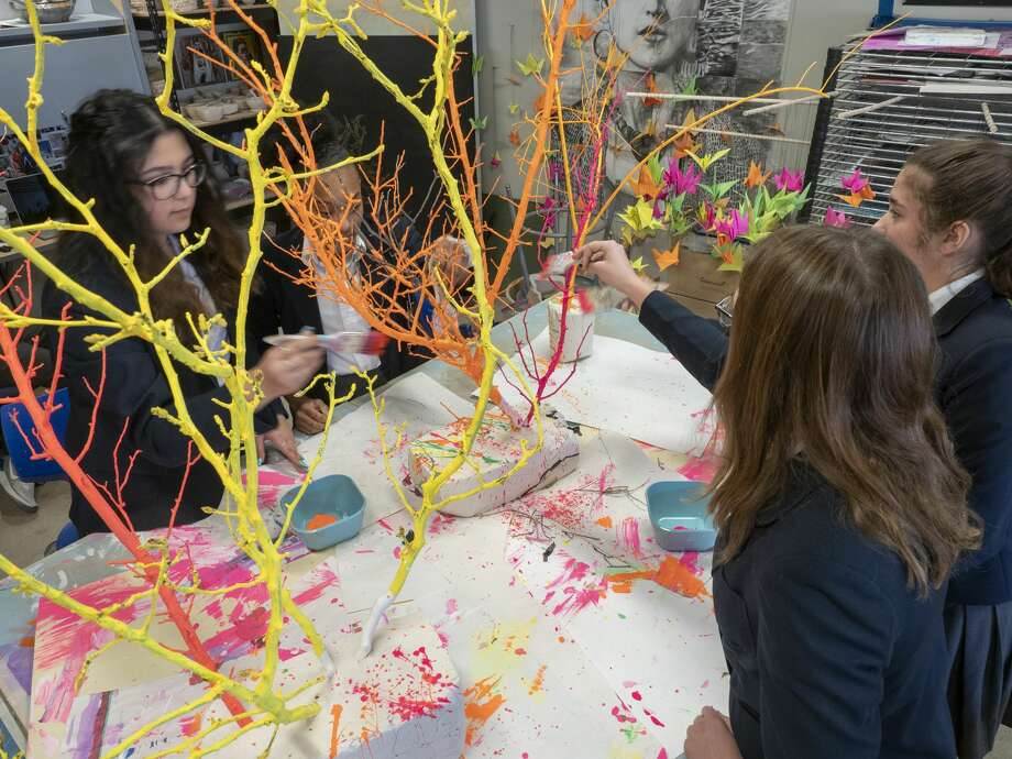 Trinity students work on painting trees in glow-in-the-dark paints 01/29/2020 for one of the pieces that will be in the Glowtastic exhibit. Tim Fischer/Reporter-Telegram Photo: Tim Fischer/Midland Reporter-Telegram