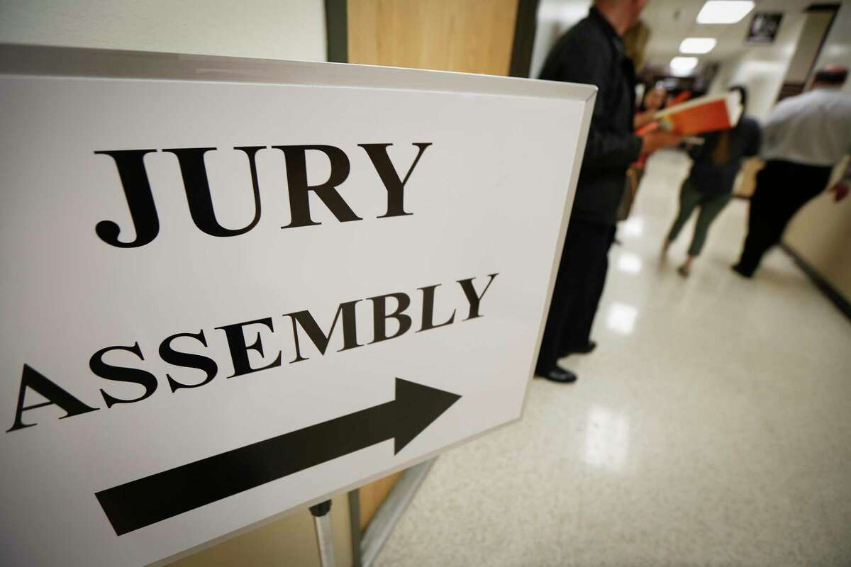 A sign directs prospective jurors to the assembly room. Hurricane Harvey decimated the original Jury Plaza.
