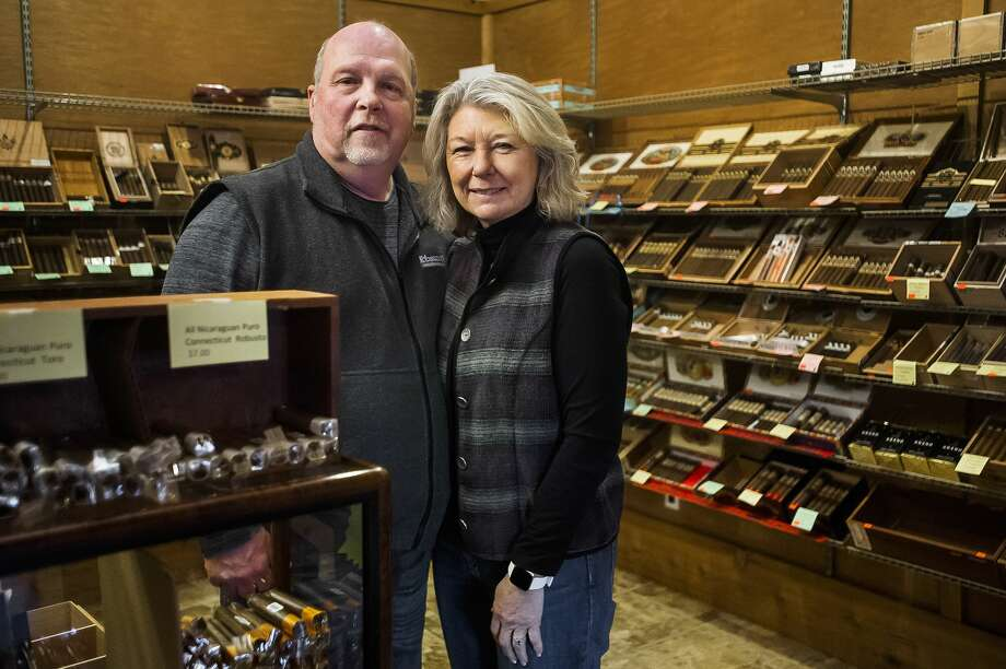 Sharon and Kevin Fitzgerald, owners of Tobacco Shoppe of Midland, pose for a portrait Tuesday inside the store. The business is celebrating its 25th anniversary. (Katy Kildee/kkildee@mdn.net) Photo: (Katy Kildee/kkildee@mdn.net)