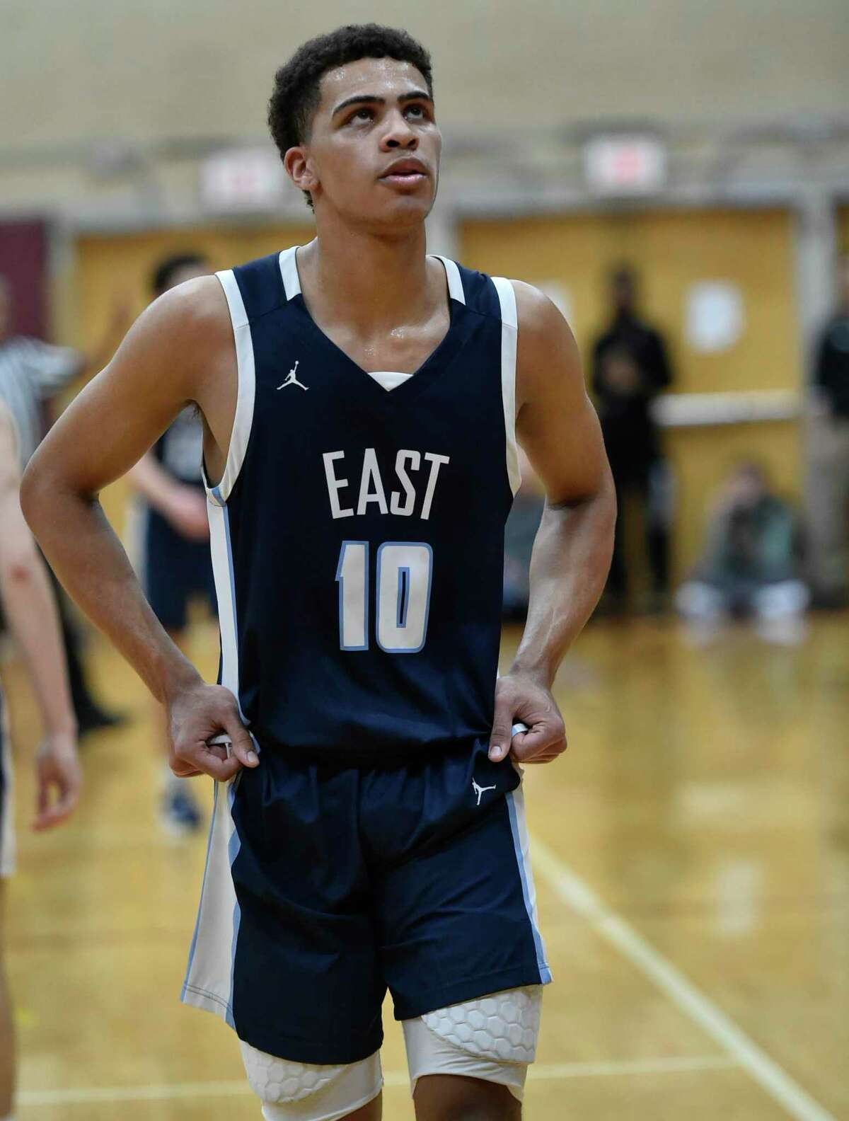 Windsor, Connecticut - January 28, 2020: Matt Knowling of East Catholic H.S. looks at the scoreboard during second quarter boys basketball Tuesday evening against Windsor H.S. at Windsor.. Final: #2 Windsor H.S. defeats #1 East Catholic H.S. 48-45.