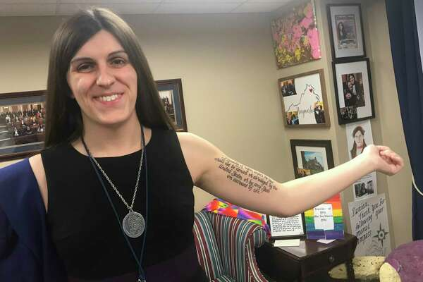 Virginia Rep. Danica Roem, D-Prince William, displays her Equal Rights Amendment tattoo in her Richmond office.