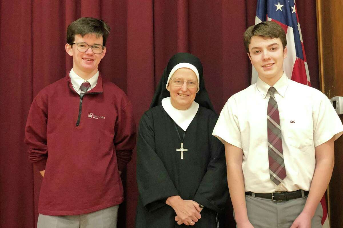 St. John School in Old Saybrook Ryan Coffey and Juan Pacheco-O'Donnell are shown with Principal Elaine Moorcroft.