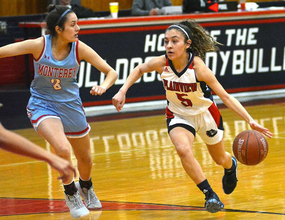 Plainview's Aaliyah Rogers drives towards the basket against Lubbock Monterey defender Mia Trevino during their District 3-5A girls basketball game on Tuesday, Jan. 28, 2020 in the Dog House. Photo: Nathan Giese/Planview Herald