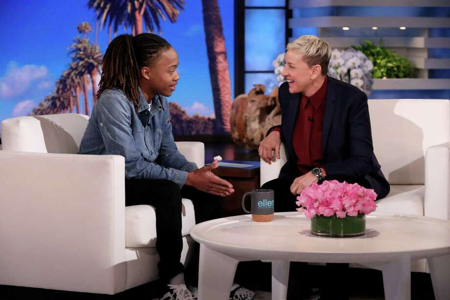 Former Barbers Hill ISD senior DeAndre Arnold meets with Ellen Degeneres on her daytime show. The senior was told that if he did not cut his dreadlocks, he would be suspended and would not be able to walk at his high school graduation. Photo: Michael Rozman/Warner Bros.