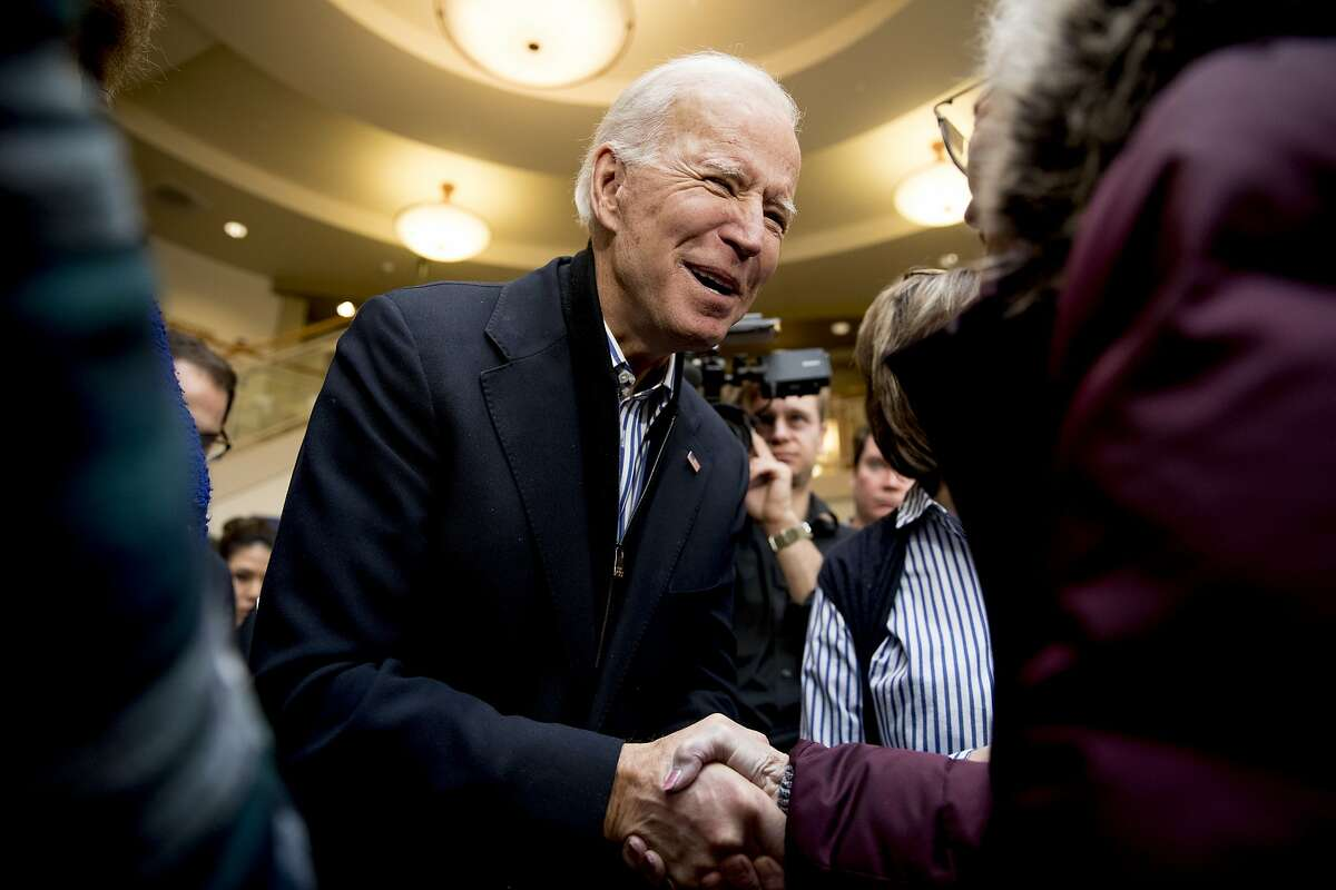 Democratic presidential candidate Joe Biden greets a member of the audience at a campaign rally at the University of Dubuque, Friday, Jan. 3, 2020, in Dubuque, Iowa. (AP Photo/Andrew Harnik)