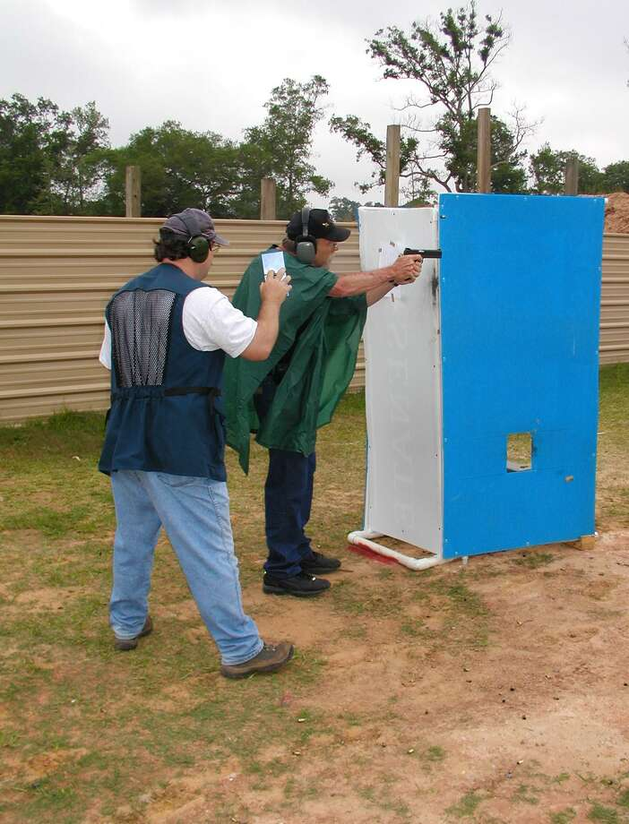 During an IDPA shoot on the firing line is the shooter and a Range Safety Officer that controls the timer and makes sure everything the competitor does is safe. Photo: Larry J. LeBlanc