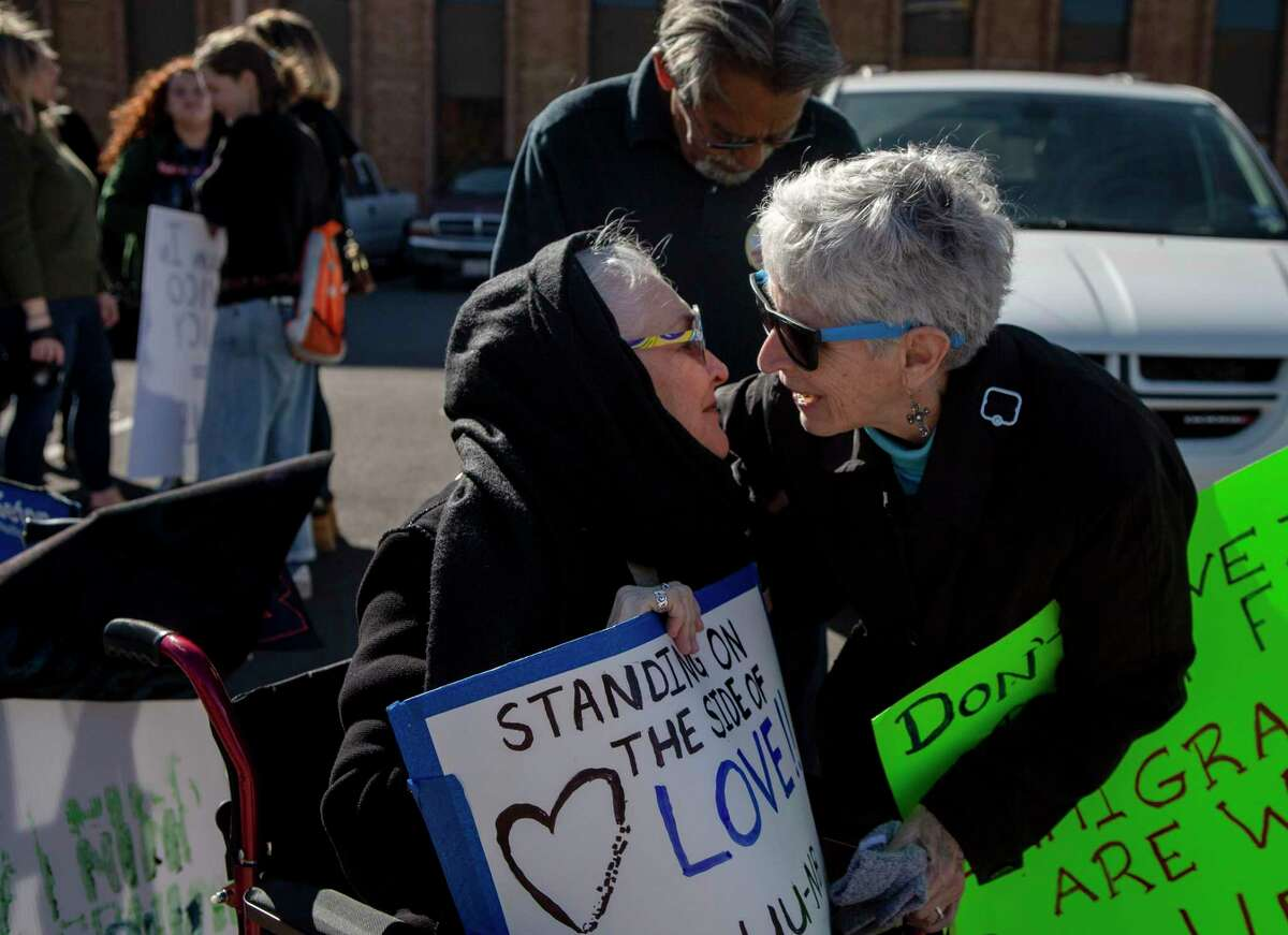 Peggy Ornelas of the Interfaith Welcome Coalition, left, embraces Sister Sharon Altendorf during a protest of the Trump administration Migrant Protection Protocols policy outside the San Antonio Immigration Court on Jan. 29, 2020. Wednesday marks one year since the Migrant Protection Protocols policy, also known as