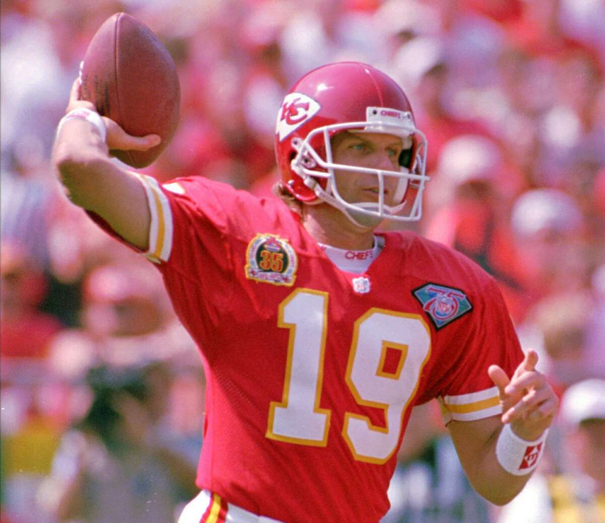 FILE--Kansas City Chiefs quarterback Joe Montana tosses a pass during the first half of Sunday's game, Sept. 11, 1994, against the San Francisco 49ers at Arrowhead Stadium in Kansas City, Mo. his time, Joe is expected to go. Joe Montana's long-rumored retirement from football likely becomes official next week, the Los Angeles Times reported Tuesday. The newspaper said the quarterback's friends and family will be in San Francisco for the announcement. (AP Photo/Ed Zurga)