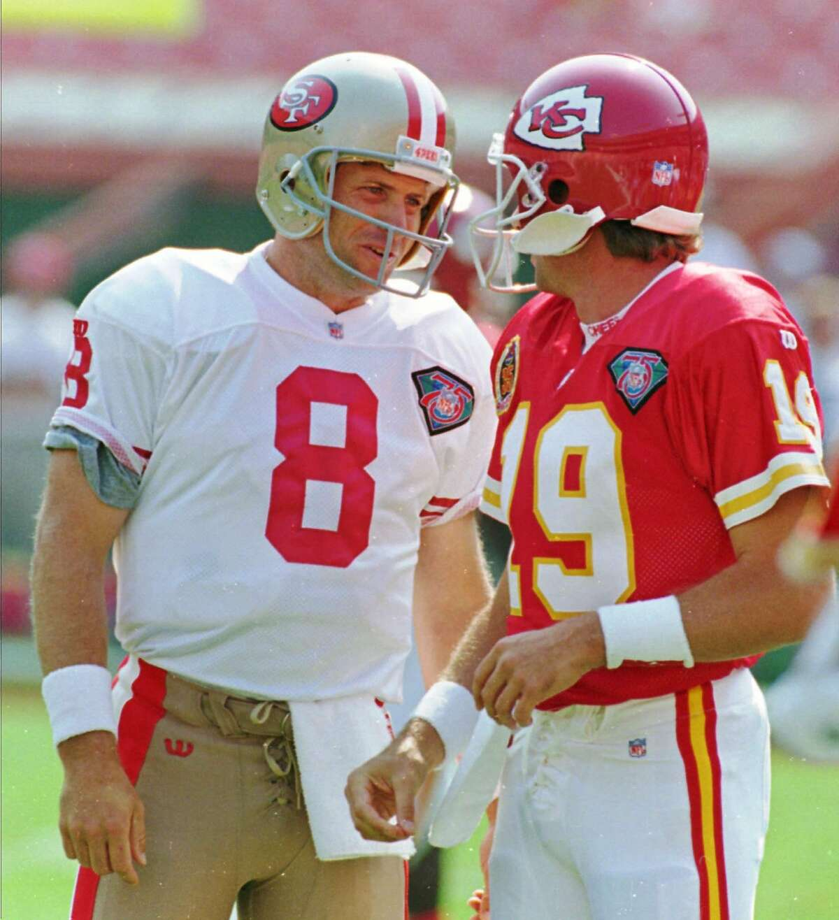 FOR USE AS DESIRED--FILE--Kansas City Chiefs quarterback Joe Montana, right, chats with San Francisco 49ers quarterback Steve Young prior to their game on Sept. 10, 1994, in Kansas City, Mo. Young was Montana's backup in the1989-90 Super Bowl wins by the 49ers. (AP Photo/Cliff Schiappa, file)