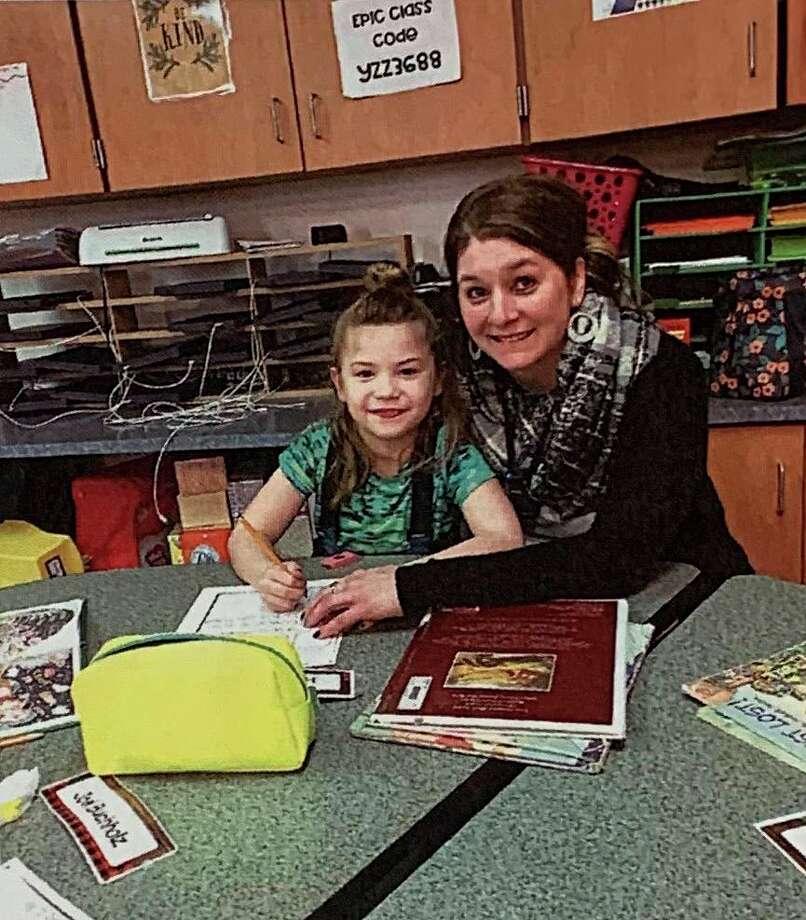 Shannon Popham, right, with a student. (Courtesy photo/Shannon Popham)