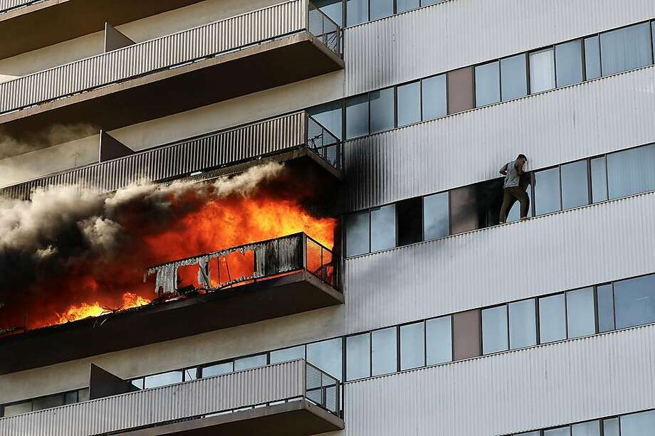 Firefighters on Wednesday, Jan. 29, 2020 battle a large blaze that has enveloped the sixth floor of a 25-story residential building in Los Angeles, forcing residents to evacuate from the structure. (Al Seib/Los Angeles Times/TNS) Photo: Al Seib, TNS