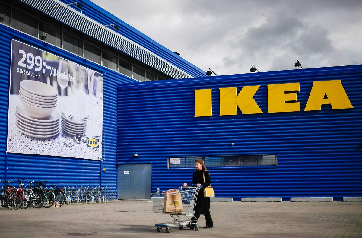 (FILES) In this file photo taken on March 30, 2016, a woman walks outside Europe's biggest Ikea store is pictured in Kungens Kurva, south-west of Stockholm. - Swedish furniture giant Ikea said on January 29, 2020 it had temporarily closed half of its 30 stores in mainland China until further notice amid concerns over the deadly new coronavirus. (Photo by JONATHAN NACKSTRAND / AFP) (Photo by JONATHAN NACKSTRAND/AFP via Getty Images)