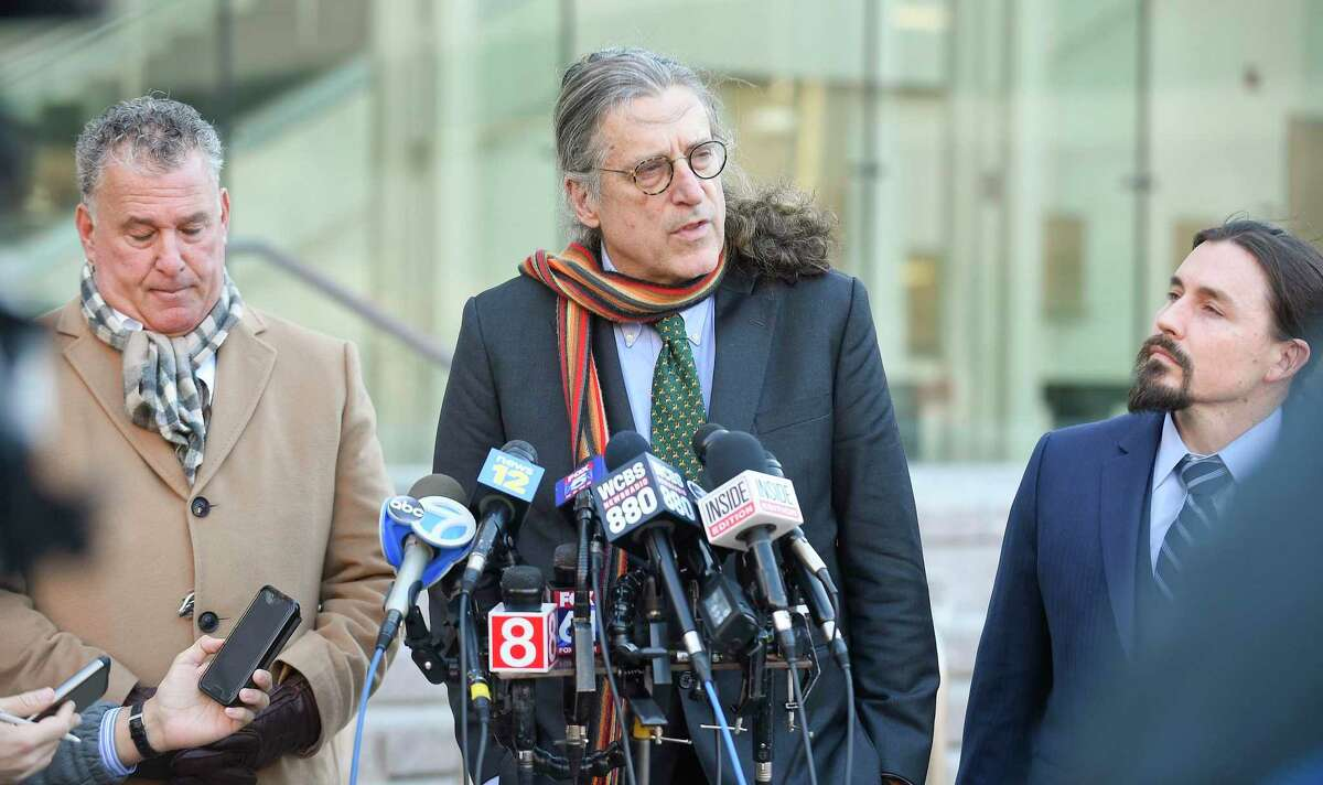 Attorney Norman Pattis, lead defense attorney for Fotis Dulos, speaks to the media outside the Superior Courthouse in Stamford, Connecticut on Jan. 29, 2020 following a bond hearing for his client. Standing with Pattis, from left, Bondsman Ira Judelson and Attorney Kevin Smith.