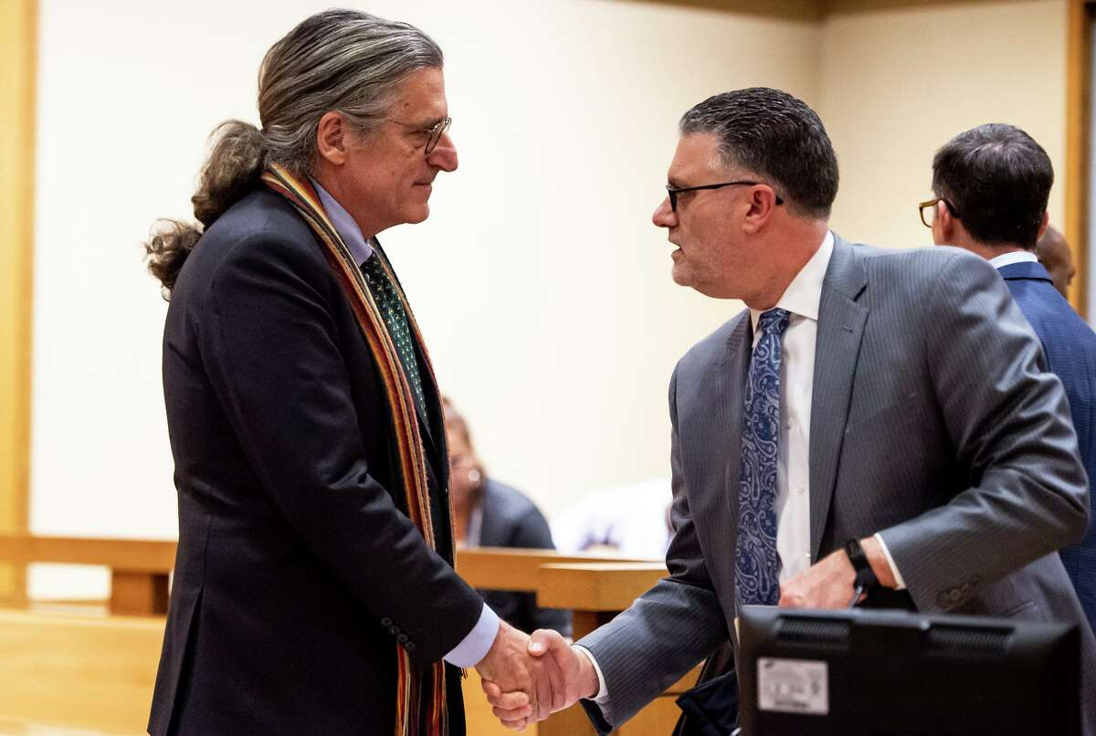 """Norm Pattis (left), Fotis Dulos' attorney, shakes hands with Stamford State?•s Attorney Richard Colangelo after they reached an agreement during a bond hearing for Dulos, who is in critical condition in a New York hospital after a suicide attempt, at the State of Connecticut Superior Court Wednesday, Jan. 29, 2020, in Stamford. Judge Gary White ordered three new re-arrest warrants for Fotis Dulos, who is charged with killing his estranged wife but is now in ?'dire condition?"""" in a New York hospital after a suicide attempt. (Kassi Jackson/Hartford Courant/pool photo)"""