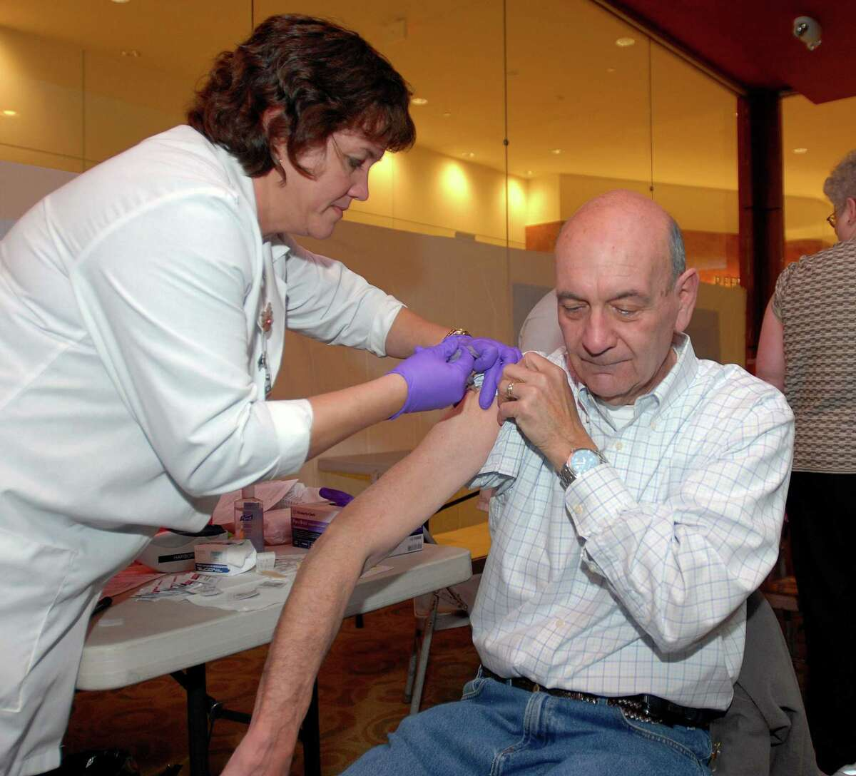 A Stratford man gets a H1-N1 flu vaccination during an influeza clinic at the Westfield Connecticut Post Mall.