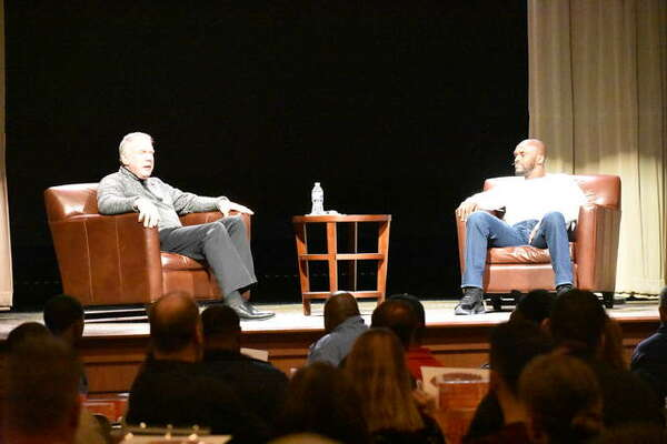 Former St. Louis Rams wide receiver Isaac Bruce, right, discusses the 1999 season with Randy Karraker during the FCA 618Luncheon on Friday at Metro Community Church.