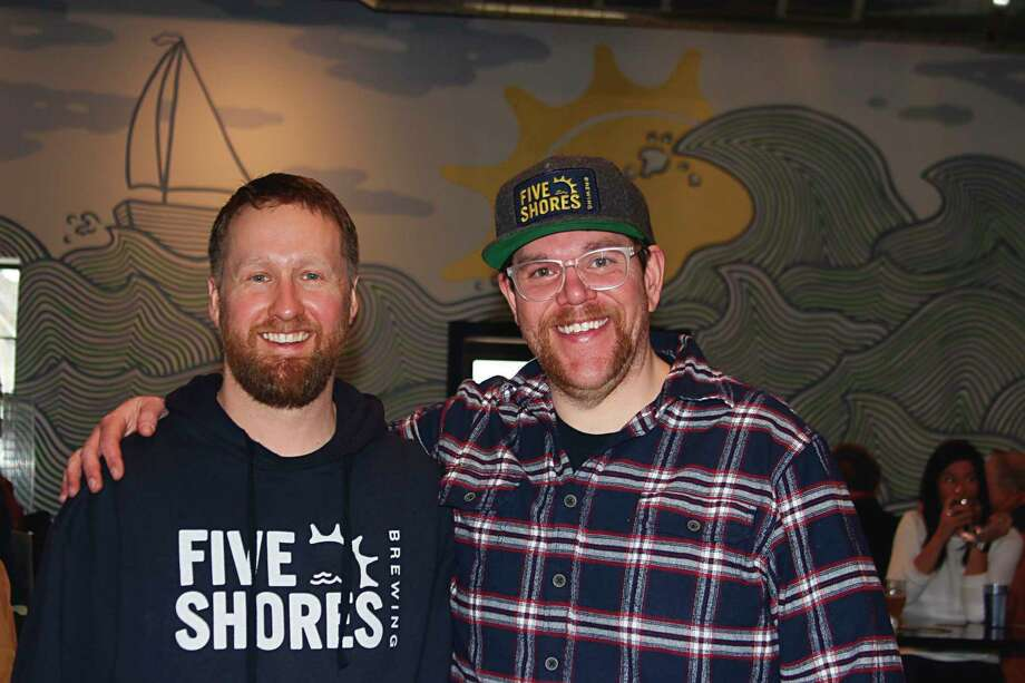 Co-founders Oliver Roberts (left) (brewmaster) and Matt Demorest celebratethe grand opening of their brewery, Five Shores Brewing.(Colin Merry/Pioneer News Network)