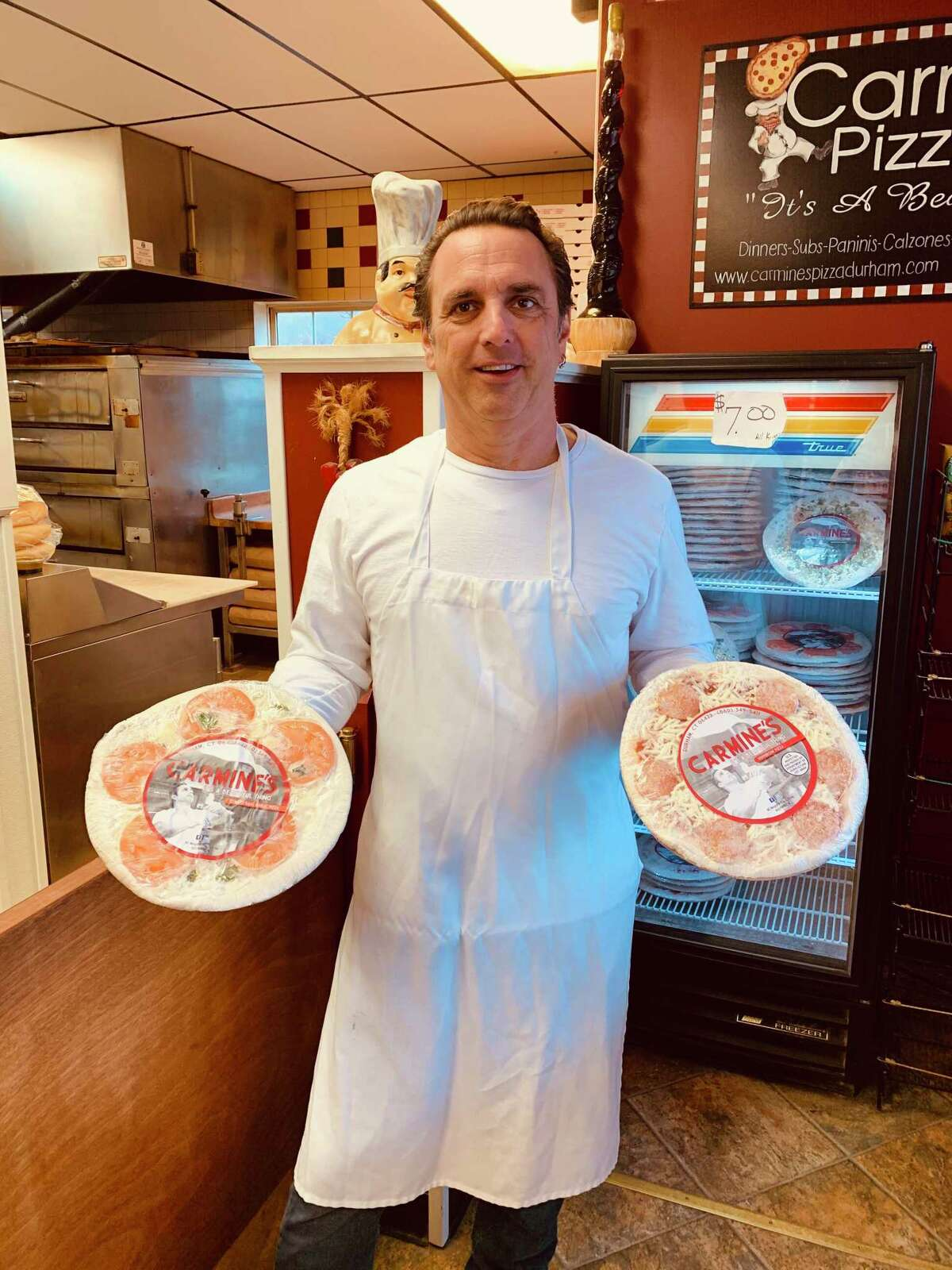 For nearly 18 years, Heath Andranovich, owner of Carmine's Pizza & Italian Takeout and Carmine's Frozen Pizzas, has been creating his New Haven-style gourmet pies with locally sourced ingredients using his 100-year-old family recipe.