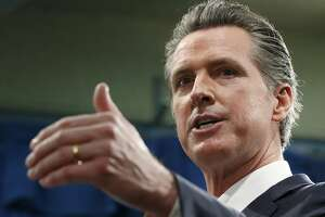 File - In this Jan. 10, 2020, file photo, California Gov. Gavin Newsom responds to reporters question during a news conference in Sacramento, Calif. Pacific Gas & Electric is assuring a federal judge Wednesday, Jan. 29, 2020, it will meet a June 30 deadline for getting out of bankruptcy, as California Gov. Gavin Newsom signaled his intent to follow through on his threat to attempt a government takeover of the nation's largest utility. (AP Photo/Rich Pedroncelli, File)