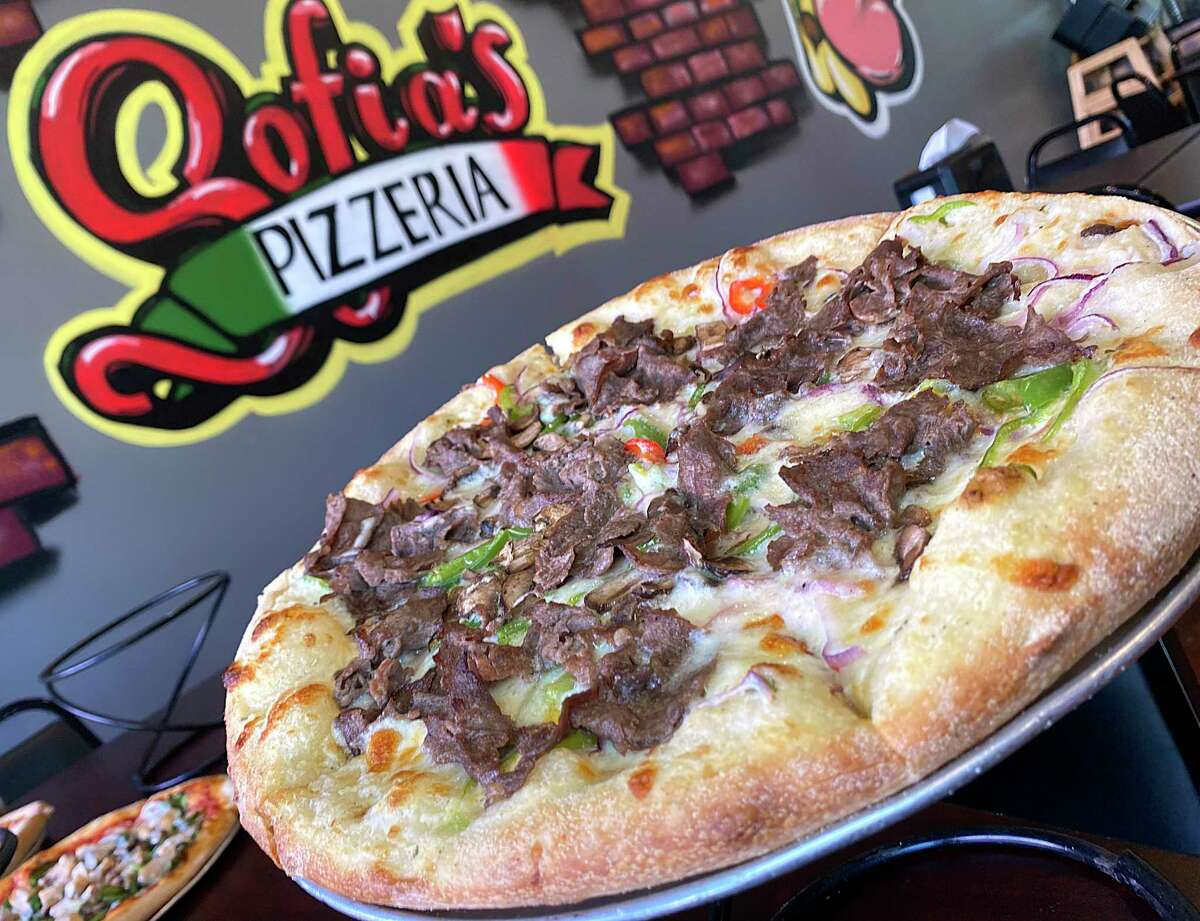 The Philly cheesesteak pizza includes shaved sirloin, onions, bell peppers, mushrooms, mozzarella cheese and creamy white sauce at Sofia's Pizzeria.