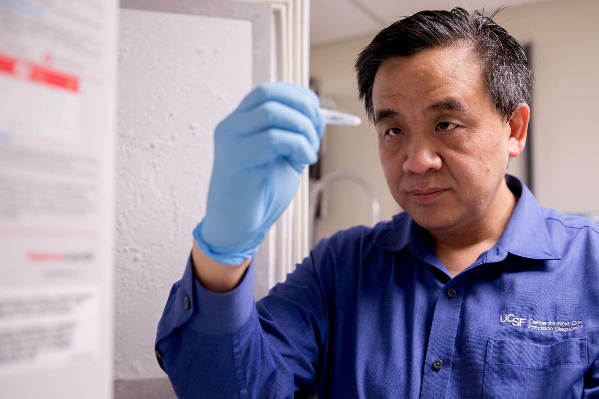 Dr. Charles Chiu takes out a sample of an infectious disease stored in the freezers in the lab at the UCSF Mission Bay campus in San Francisco, Calif. Wednesday, January 29, 2020. Chiu, an associate professor and director of a center that studies emerging pathogens, has partnered with San Francisco company Mammoth Biosciences to create a simple test that could diagnose the new coronavirus within several hours.