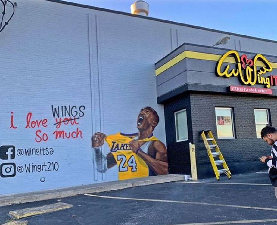 A wall at Wing It, a wing restaurant in Universal City, is now a tribute to Kobe Bryant. The art by muralist Roger Maximo shows the five-time champion in one of his celebratory moments, proudly flashing the team name he spent his entire NBA career with. Photo: Courtesy,  Wing It