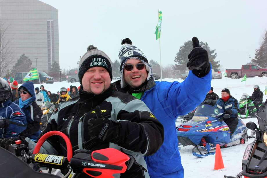 At the end of the 900-milesnowmobile endurance ride,Wertz Warriors members will giveSpecial Olympics Michiganathletes snowmobile rides.(Courtesy photo/Special Olympics Michigan)