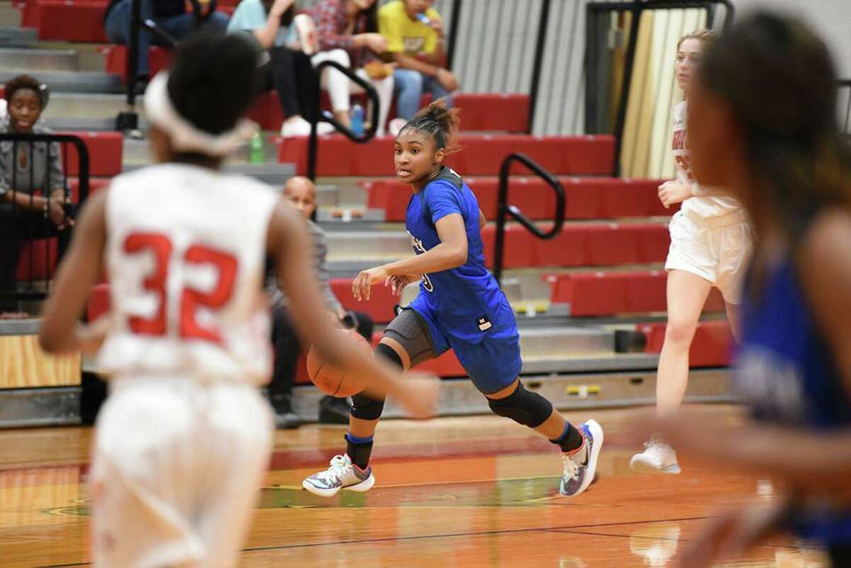 Cy Creek junior guard Rori Harmon, center, and the Lady Cougars are attempting to return to the state tournament under head coach Jennifer Alexander.