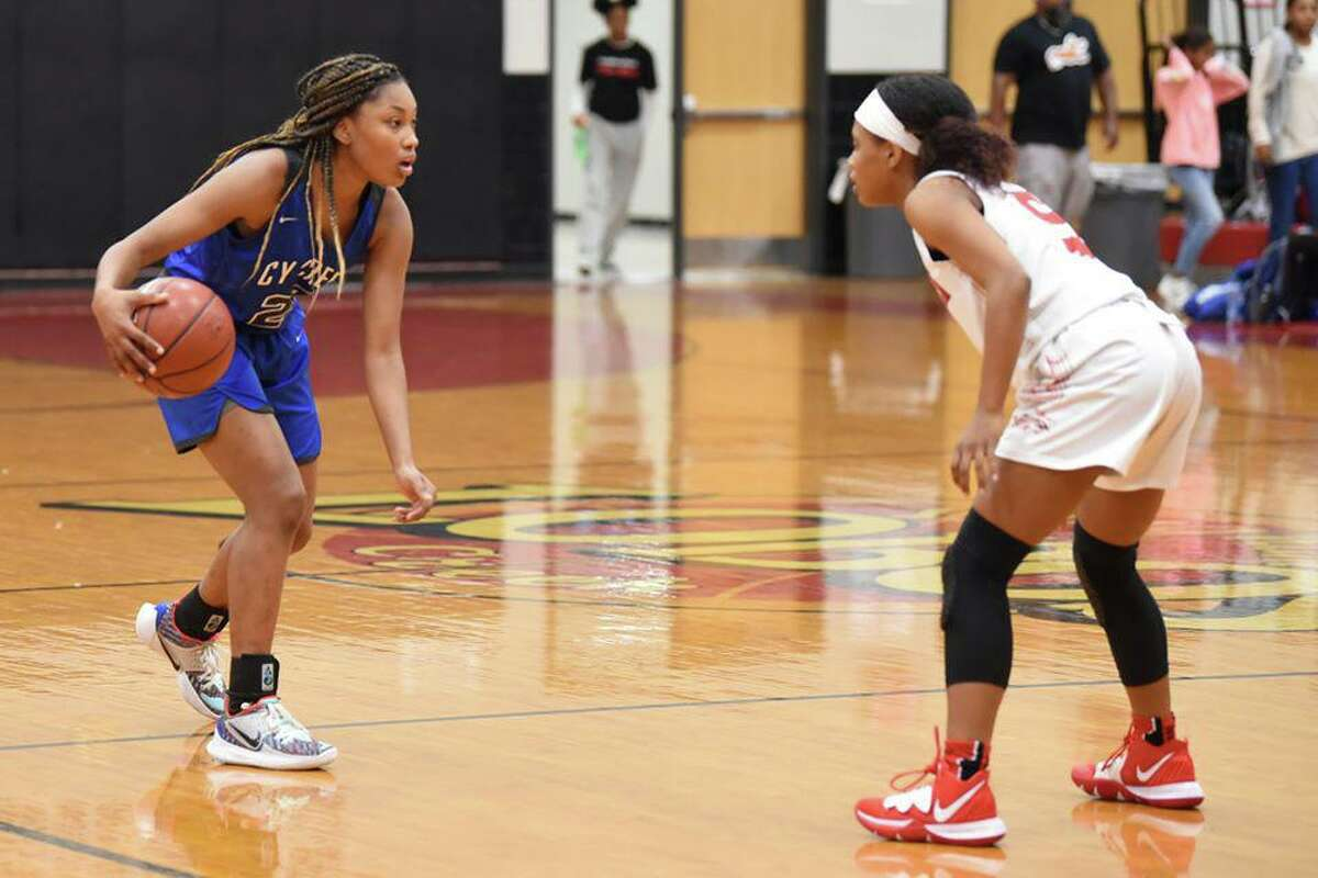Cy Creek junior guard Kyndall Hunter, left, and the Lady Cougars are in pursuit of the District 17-6A championship and more under head coach Jennifer Alexander.
