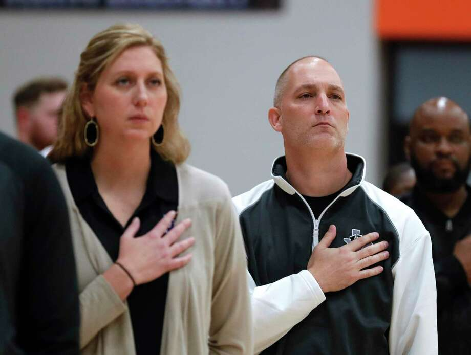 Willis head coach, Michael Storms, right, is seen beside his wife and first assistant coach, Megan, during a District 20-5A high school basketball game at Grand Oaks High School, Tuesday, Jan. 21, 2020, in Spring. Photo: Jason Fochtman, Houston Chronicle / Staff Photographer / Houston Chronicle © 2020