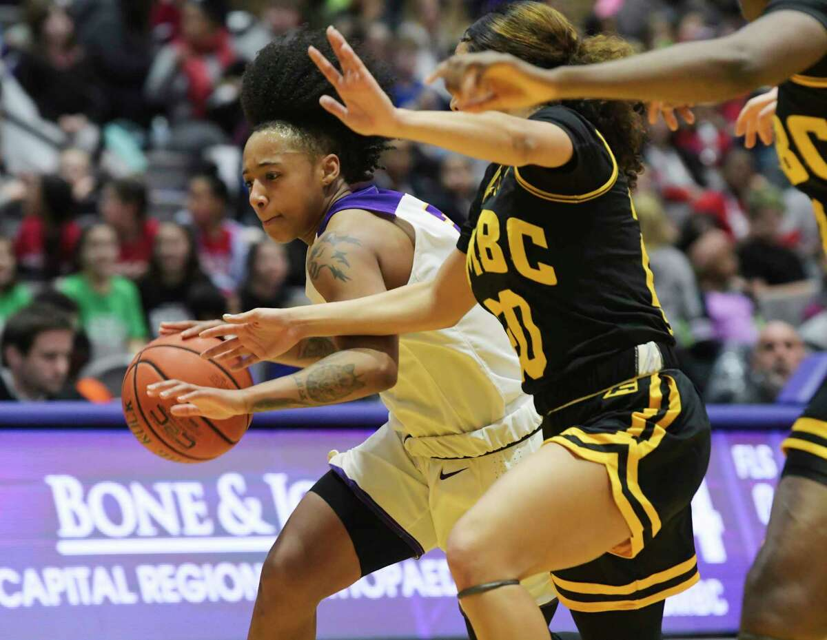 UAlbany's Kyara Frames drives around a UMBC player during their game on Wednesday, Jan. 29, 2020, in Albany, N.Y. (Paul Buckowski/Times Union)