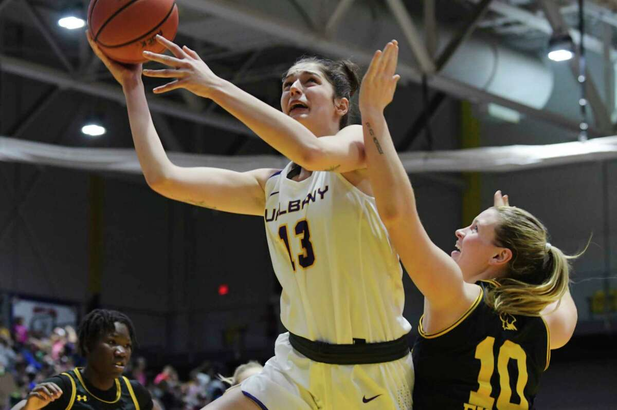 UAlbany's Lucia Decortes puts up a shot over Eryn Fisher of UMBC during their game on Wednesday, Jan. 29, 2020, in Albany, N.Y. (Paul Buckowski/Times Union)